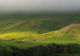 Low clouds over green mountains in Iceland