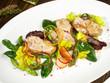 Leinwandbild Motiv Kalbsbries auf Salat mit Spargel