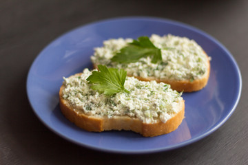 sandwiches with cottage cheese and herbs on a blue plate
