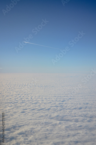 Clouds from the airplane window, from above, the sky above the ground, from the plane. - 237731805