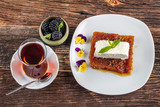 Traditional Turkish dessert is Turkish Bread Pudding In Syrup(Ekmek Kadayifi)made with dehydrated bread soaked in syrup and Topped with the thick Turkish clotted cream (kaymak) or serv with ice cream.