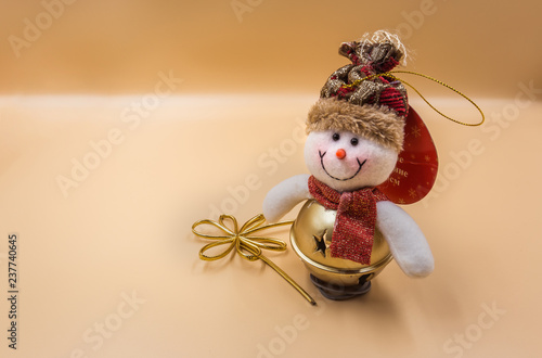 Christmas tree toy snowman on beige background
