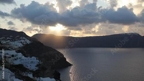 Wide, sun sets over Santorini