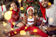 Portrait of family in front of Christmas tree. - 237753258