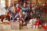 Christmas family portrait - family in front of beautiful Christmas tree. - 237754037