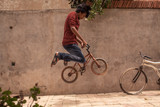 Boy jumping on bike
