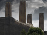 Four Tall Chimneys Against A Stormy Sky - 237765608