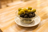 Olives in a cup on a table in Barcelona, Spain - 237792256