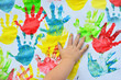 Multicolor handprint of little girl on the white background