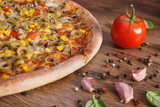 Vegetarian pizza and ingredients with spices, fast food