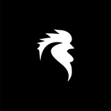 Rooster head icon or logo on dark background