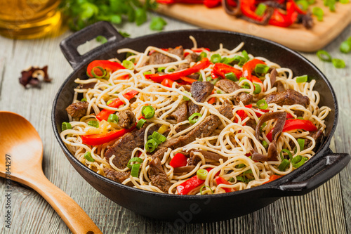 Chinese pasta with beef. Prepared in wok. - 237844297