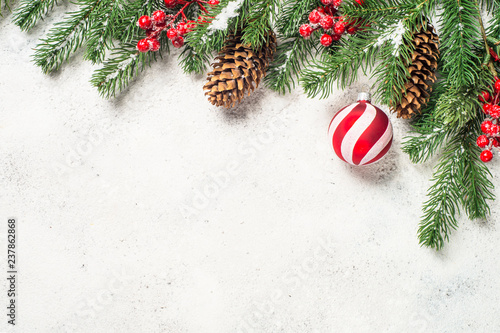 Christmas background with fir tree, red balls and decorations on