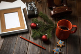 Photos, camera, pine tree branch and cup of coffee.