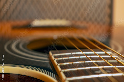 Classic vintage acoustic guitar with visible frats and wires. Close-up view - 237911668