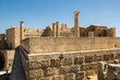 Lindos Acropolis fortified citadel during summer touristic season, archeology ruins