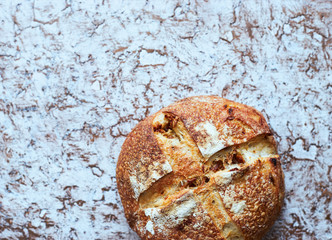Hot homemade organic French round bread with onion top view Space for text