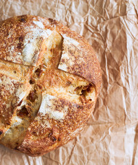 Hot homemade organic French round bread with onion top view