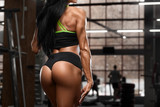Sexy beautiful butt in thong. Sexy athletic girl. Fitness woman in gym