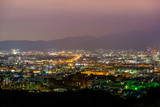 Beautiful nightview of Kyoto cityscape with mountains in the background