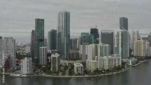 Fototapeta Aerial push heading towards buildings in downtown Miami
