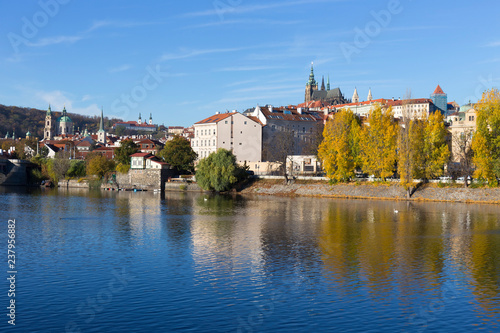 Foto Murales Colorful autumn Prague gothic Castle with the Lesser Town above River Vltava in the sunny Day, Czech Republic