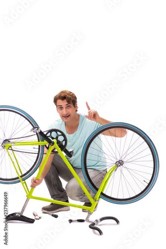 Man repairing his bike isolated on white background