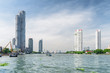 The Chao Phraya River and high-rise residential buildings