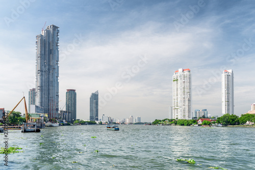 Foto Murales The Chao Phraya River and high-rise residential buildings