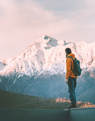 Man adventurer alone enjoying sunset mountains view active lifestyle winter vacations outdoor hiking adventure solo trip