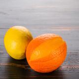 citrus orange and lemon on a dark wooden background