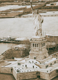 Overhead aerial view of Statue of Liberty from helicopter, New York City in winter - 238022849