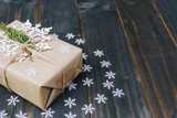 Christmas gift box placed and white snowflakes on wooden planks with space. - 238031074