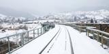 railway in snow on the railway bridge in the mountains