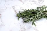 rosemary herb on white marble - 238044833