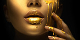 Golden paint smudges drips from the face lips and hand, golden liquid drops on beautiful model girl's mouth, creative abstract makeup. Beauty woman face - 238048602