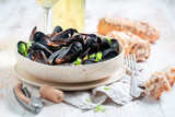 Yummy mussels served with tasty wholemeal bread - 238048825