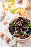 Spicy mussels with coriander and chili peppers - 238048857
