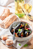 Yummy mussels with garlic and fresh coriander - 238048879