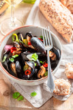 Spicy mussels with garlic and fresh coriander - 238048880
