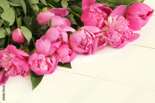 Bouquet of small pink peonies on white painted wooden table. Closeup - 238049498