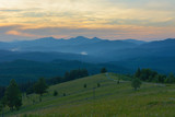 Sunset in the mountains in the summer.
