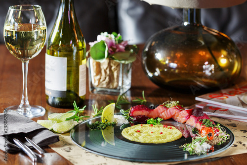 Dinner at the restaurant, dish and wine on the table - 238062806