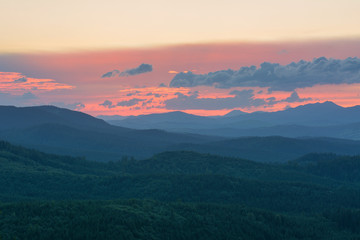 Sunset in the mountains in the summer. © yushel