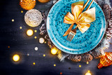 Christmas holiday dinner table setting. Xmas table decoration with blue plate, colorful decor and candles. Top view, flatlay - 238074440