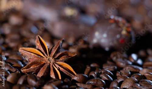 Leinwandbild Motiv Coffee beans background with different spices: anise stars and cinnamon sticks. Christmas concept.