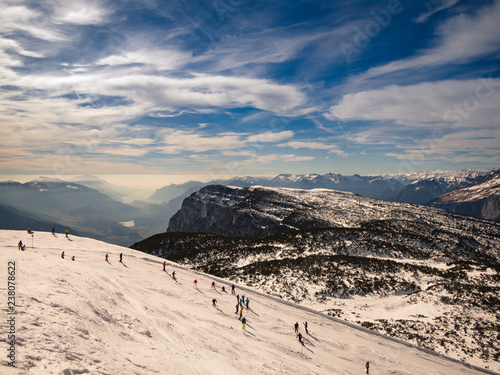 Ski slope and snow-capped mountains in the background. - 238078622