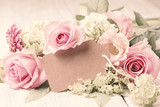 Beautiful rose flowers with blank lable