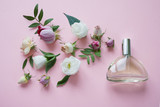 Flower arrangement. Flowers, fragrance, perfume on pink background.