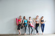 Leinwanddruck Bild - Group of female friends in sportswear together standing in a gym after yoga.